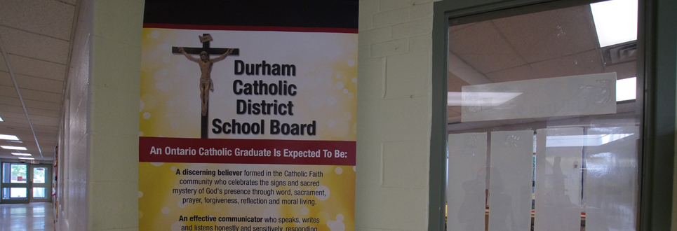 Stand-up sign stating the Catholic Graduate Expectations.